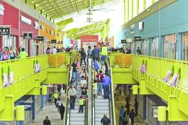 Shoppers explore the Outlet Shoppes on Thursday as the stores open their doors to the public for the first time.