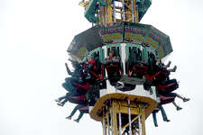 Families enjoy the carnival rides at this year's annual Nederland Heritage Festival. Carnival rides, food booths, entertainment, and games pack Boston Avenue, offering something for all ages at the popular spring event. The event continues through Sunday, and will feature a parade 10 a.m. Saturday, as well as a chili cook-off. Photo taken Thursday, March 16, 2017 Kim Brent/The Enterprise