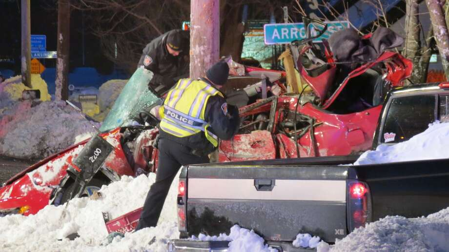 Firefighters and police investigators worked into the night Thursday after a fatal accident on Central Avenue in Colonie. The driver's car hit a snowbank and went airborne before crashing into a utility pole. (Tom Heffernan Sr. / Special to the Times Union) Photo: Picasa