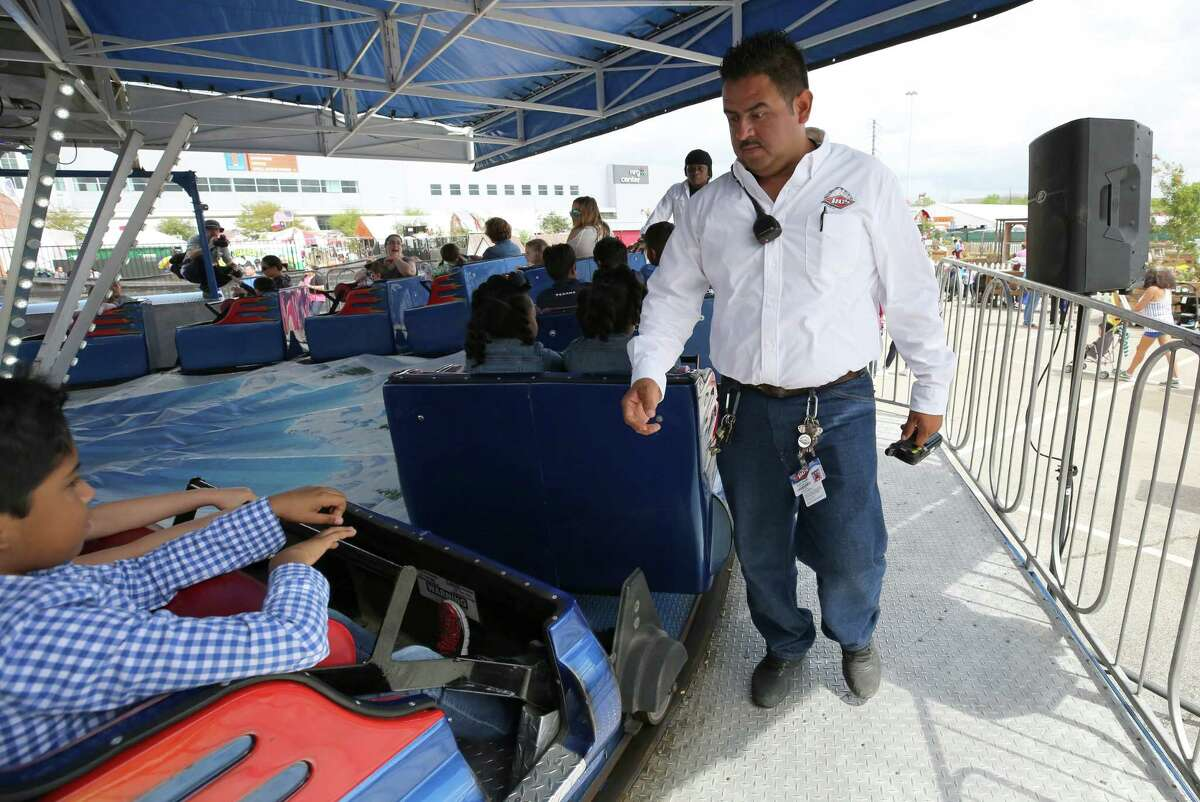 Pablo Juarez makes sure all carnival riders are secured before the start of the ride at the Houston Livestock Show and Rodeo Thursday, March 16, 2017, in Houston. Juarez, from Mexico, is one of 285 RCS Fun carnival workers at the rodeo that are H2B visa holders.