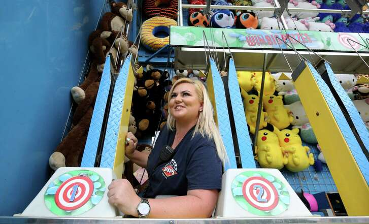 Claire Condon, from Cape Town, South Africa, works at the carnival of the Houston Livestock Show and Rodeo Thursday, March 16, 2017, in Houston. Condon is one of 285 RCS Fun carnival workers at the rodeo that are H2B visa holders.
