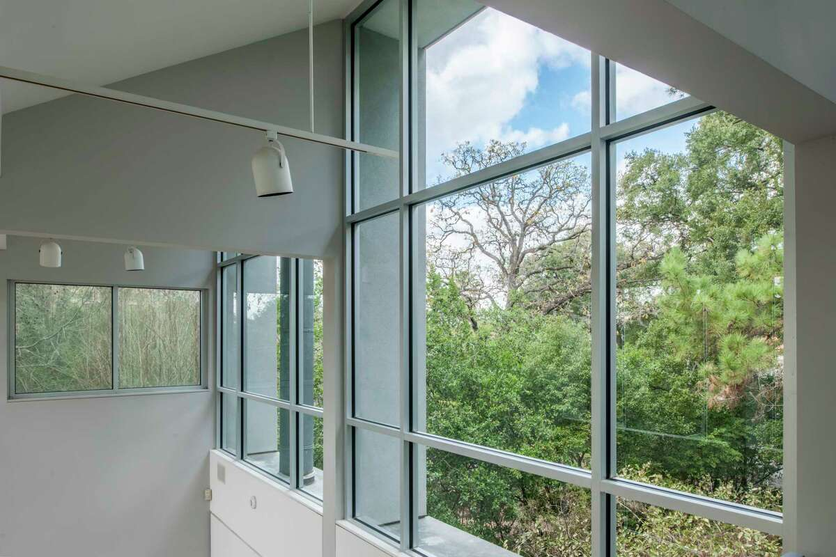 Logan Lane: Well-placed windows bring in north-facing vistas of the sky and trees, south-facing windows offer a view of Buffalo Bayou.