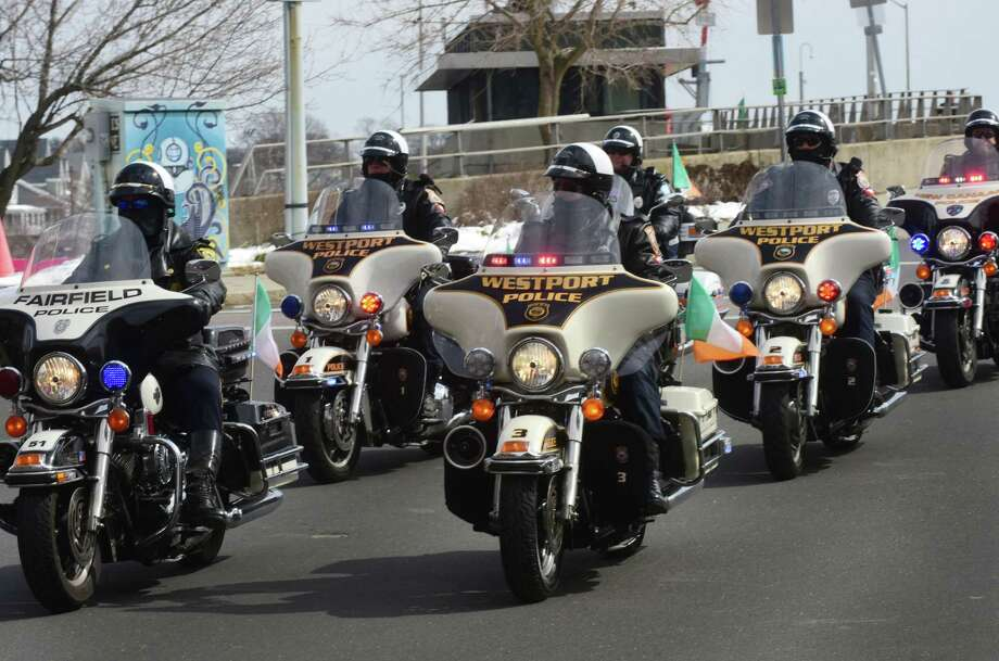 Westport and Fairfield police motorcycles participate in The Norwalk Police Emerald Society's second annual St. Patrick's Day parade March 11 in Norwalk. The parade route began at Norwalk Veterans Park, made it's way down Washington Street, under the SONO Railroad Bridge onto North Main Street, then ending at O'Neills Irish Pub and Restaurant. Photo: Erik Trautmann / Hearst Connecticut Media / Norwalk Hour