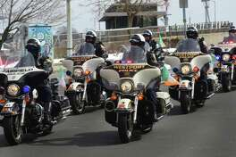 Westport and Fairfield police motorcycles participate in The Norwalk Police Emerald Society's second annual St. Patrick's Day parade March 11 in Norwalk. The parade route began at Norwalk Veterans Park, made it's way down Washington Street, under the SONO Railroad Bridge onto North Main Street, then ending at O'Neills Irish Pub and Restaurant.