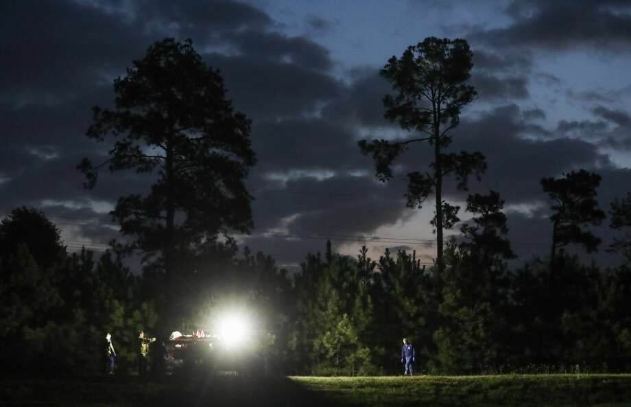 Authorities investigate the scene where a person was killed walking along train tracks in a wooded area near Louetta Road and Vintage Preserve Parkway, Friday, March 17, 2017, in Houston. Photo: Jon Shapley/Houston Chronicle