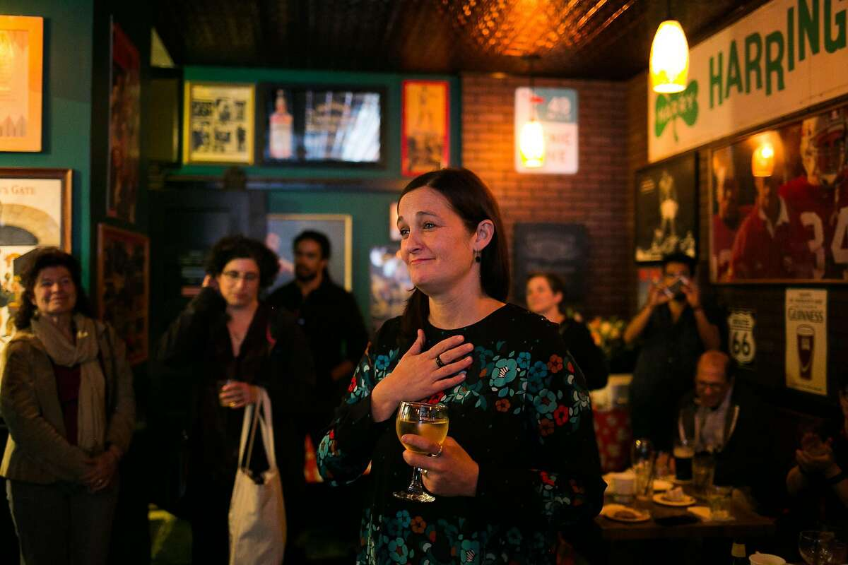 Jackie Jenks reacts to the remarks from her co-workers during her farewell party at Harry Harrington's Pub in San Francisco, Calif. Thursday, March 16, 2017.
