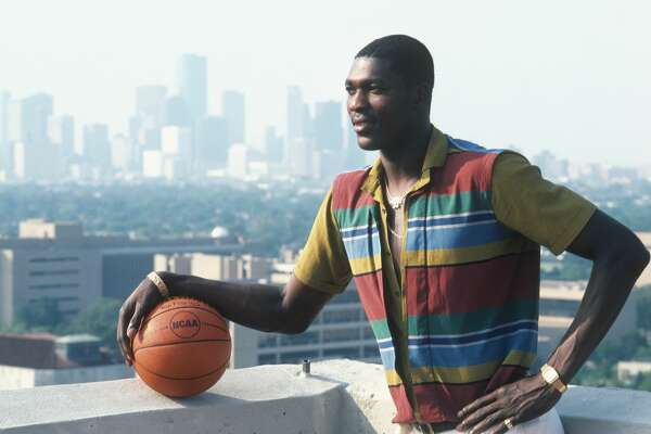 HOUSTON - UNDATED: Hakeem Olajuwon #34 of the Houston Rockets poses infront of the Houston skyline for a photo in Houston, Texas. (Photo by Focus on Sport/Getty Images)