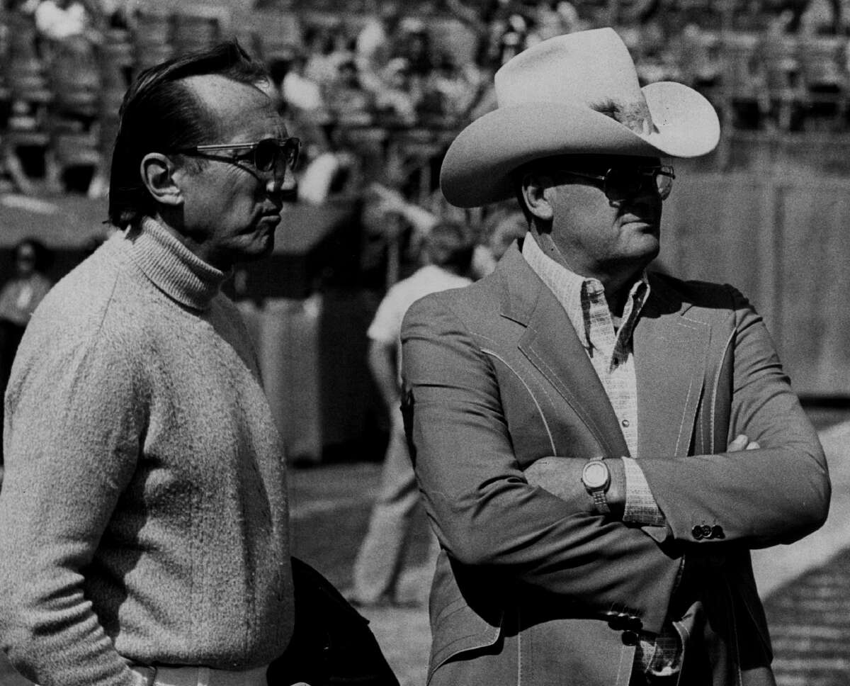 Bum Phillips of the Houston Oilers looks on circa 1970s accompanied by Raiders owner Al Davis.