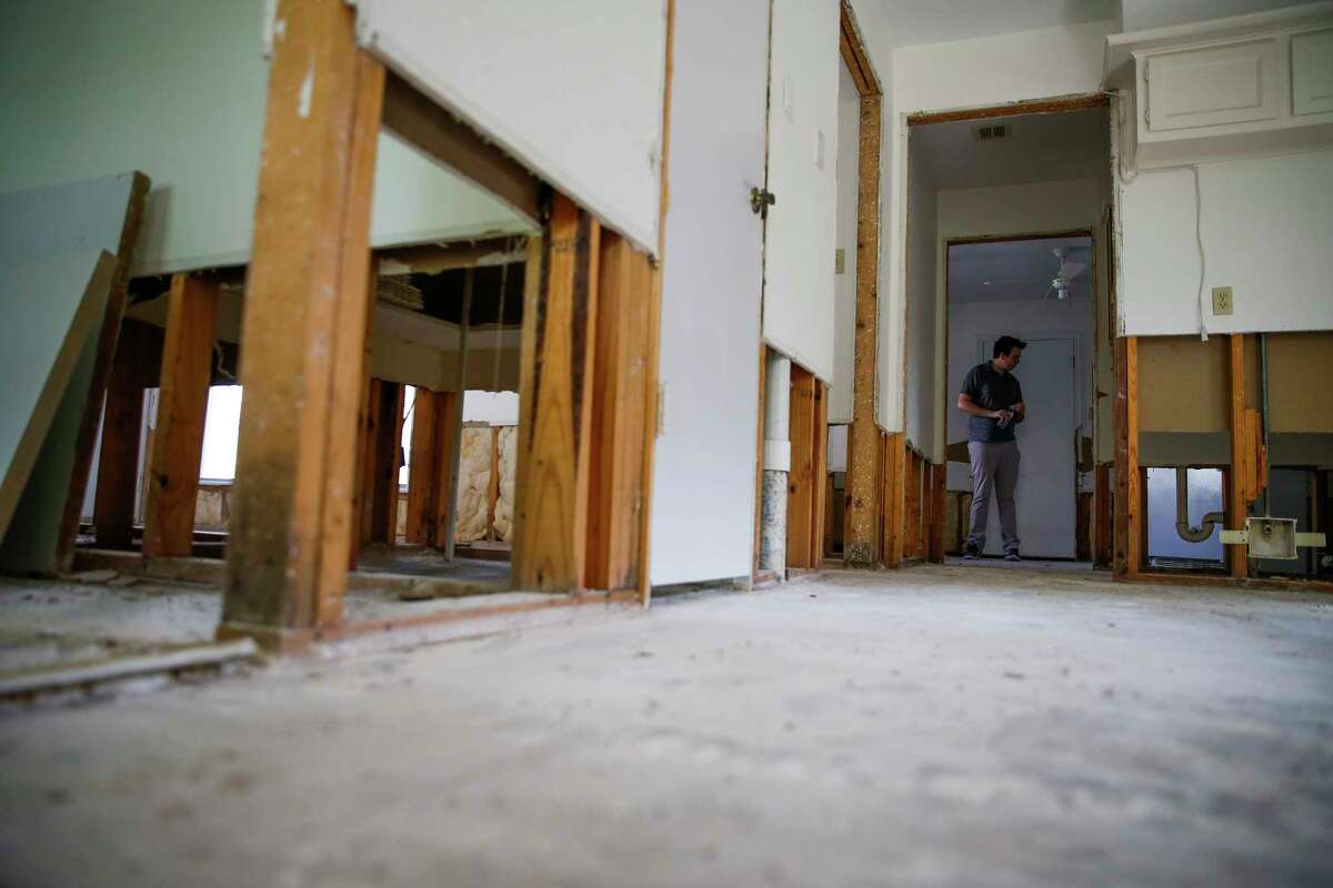 Christian Rumscheidt walks through his house Wednesday, March 8, 2017, which is still undergoing repairs after it was flooded last April. ( Michael Ciaglo / Houston Chronicle )
