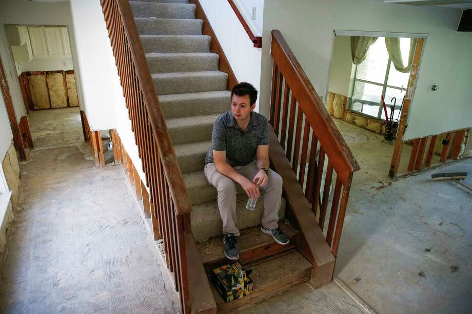 Christian Rumscheidt  sits on the stairs in his house Wednesday, March 8, 2017, which is still undergoing repairs after it was flooded last April. ( Michael Ciaglo / Houston Chronicle ) Photo: Michael Ciaglo, Staff / Michael Ciaglo