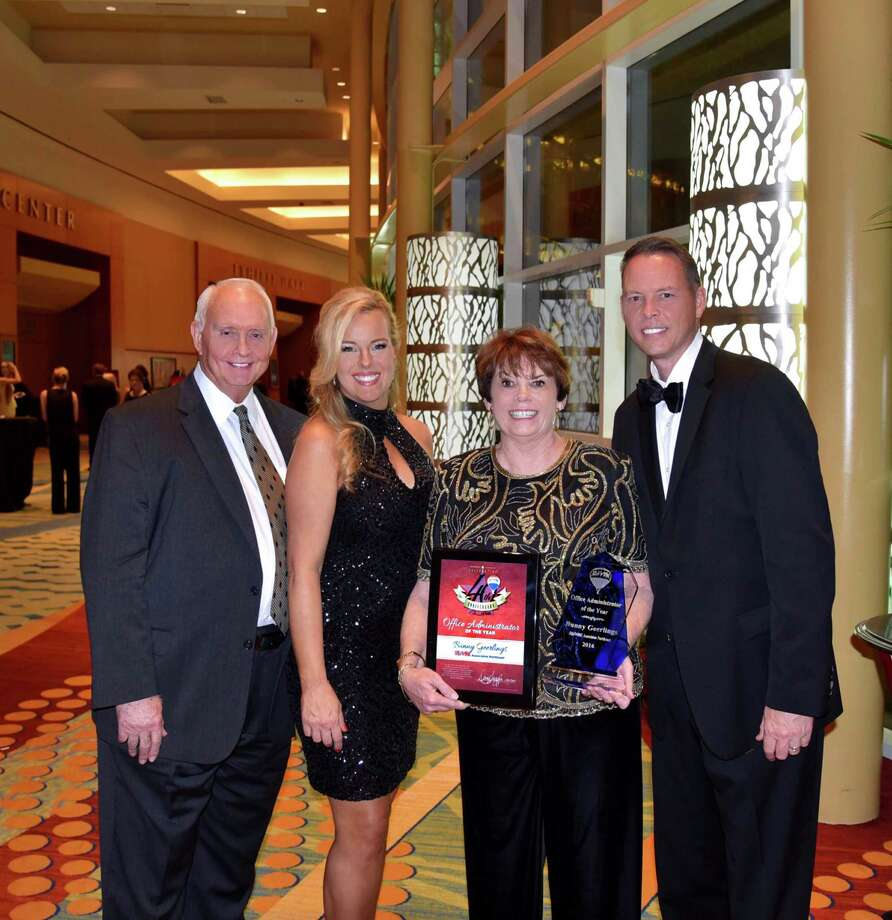 From left, Buddy Wall, broker; Candace Wall, co-owner; Bunny Geerlings, operations manager; and Rex Wall, co-owner at RE/MAX Associates Northeast, celebrate Geerlings' recognition as Office Administrator of the Year at the RE/MAX of Texas Statewide Convention held recently in The Woodlands.