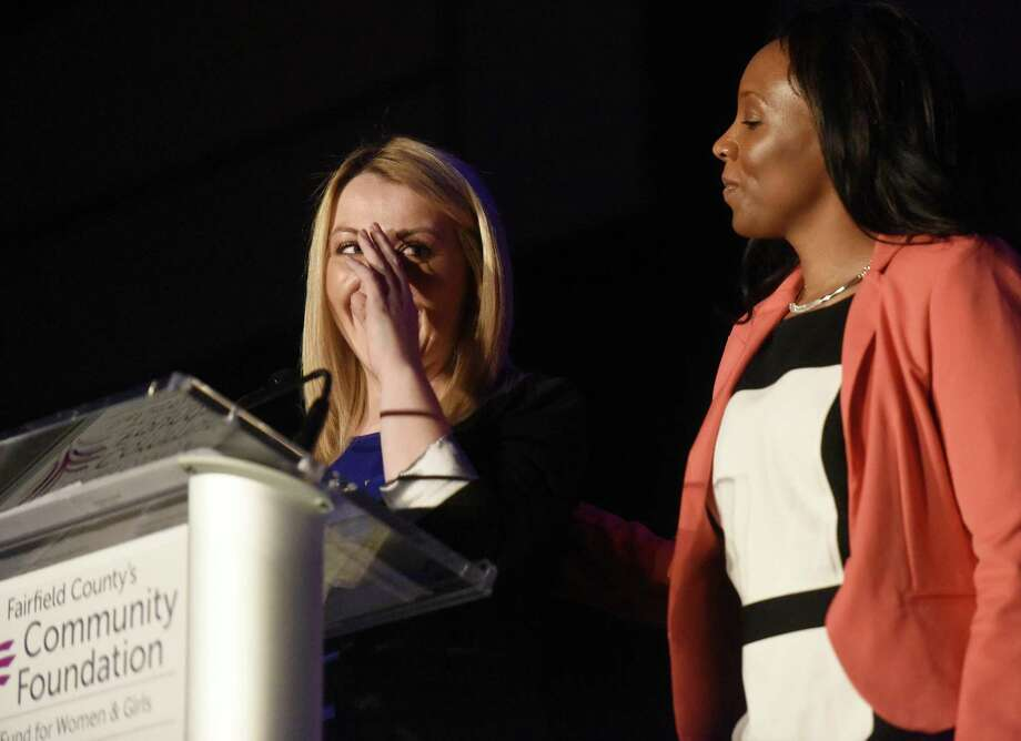 Family Economic Security Program (FESP) recipicent Heather Harrick, left, wipes away tears and is comforted by fellow FESP recipient Regina Scates while telling her story at Fairfield County's Community Foundation's Fund for Women and Girls Annual Luncheon at the Hyatt Regency ballroom in Old Greenwich, Conn. Thursday, April 7, 2016. Retired U.S. soccer player Abby Wambach then delivered the keynote presentation and answered questions to the luncheon's theme - the strength, resiliency and power of women and girls. She also addressed her recent driving under the influence arrest, which occurred Sunday, April 3 in Portland, Oregon. Photo: Tyler Sizemore / Hearst Connecticut Media / Greenwich Time