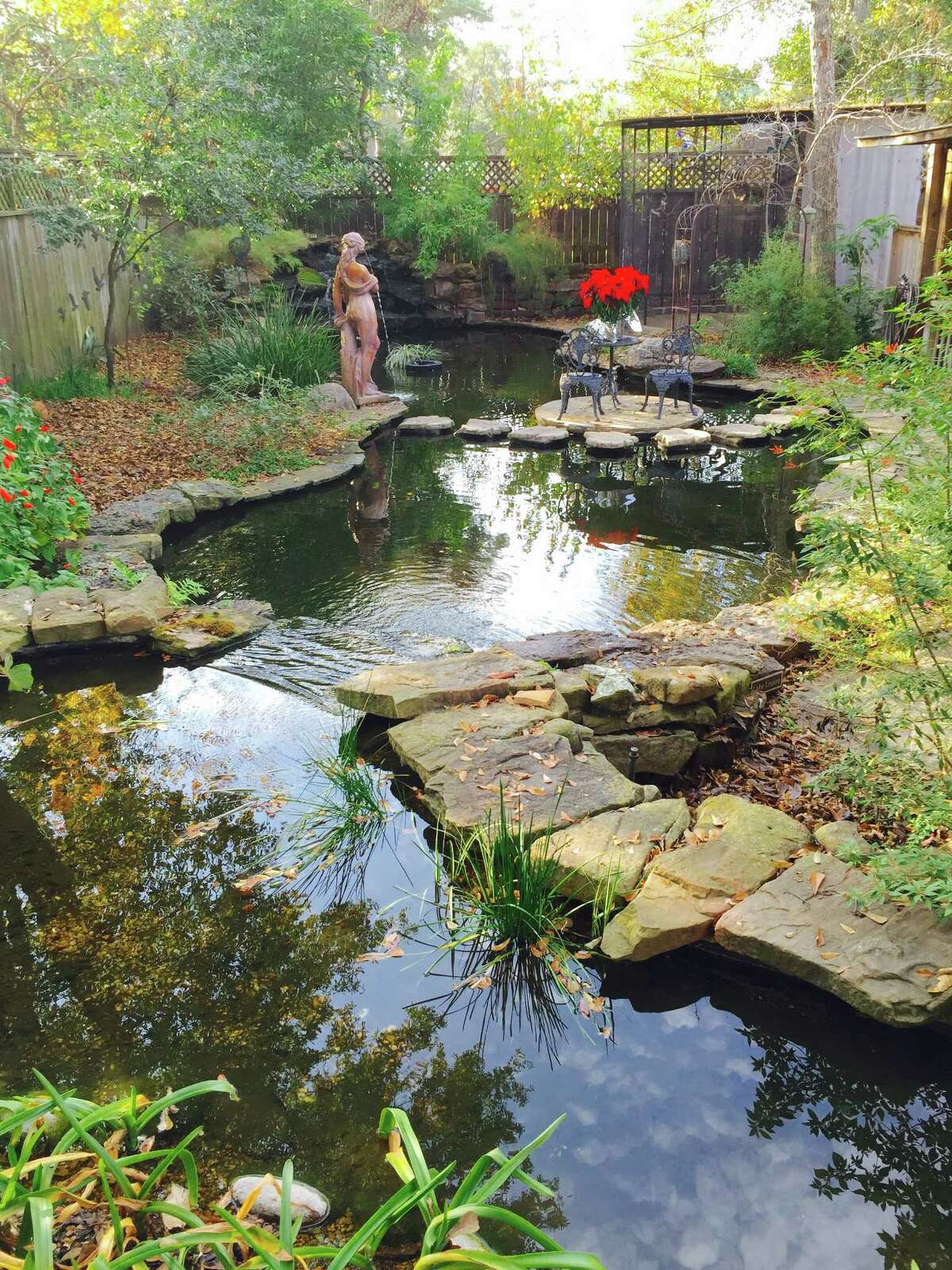 """Habitat House:One of the most dramatic features of """"Habitat House"""" is the 12,000-gallon koi pond with a bog. At this site, Peckerwood Garden will have its annual plant sale."""