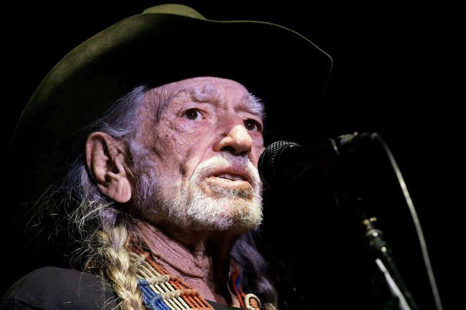 "In this Jan. 7, 2017 photo, Willie Nelson performs in Nashville, Tenn. The 83-year-old outlaw country icon wants to help a lot of people give marijuana a try. He's attached his name to a line of legal marijuana being sold in Colorado and Washington called ""Willie's Reserve,"" after decades of personally advocating for the legalization of marijuana.  (AP Photo/Mark Humphrey) Photo: Mark Humphrey, STF / Copyright 2017 The Associated Press. All rights reserved."
