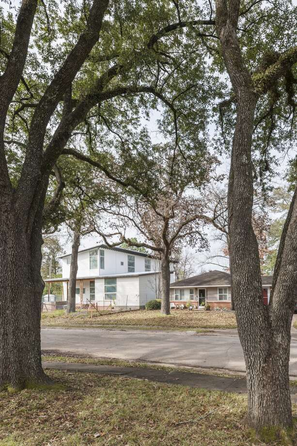 Shirkmere Lane:Low-pitched roofs blend with their neighbors' 20th century homes.