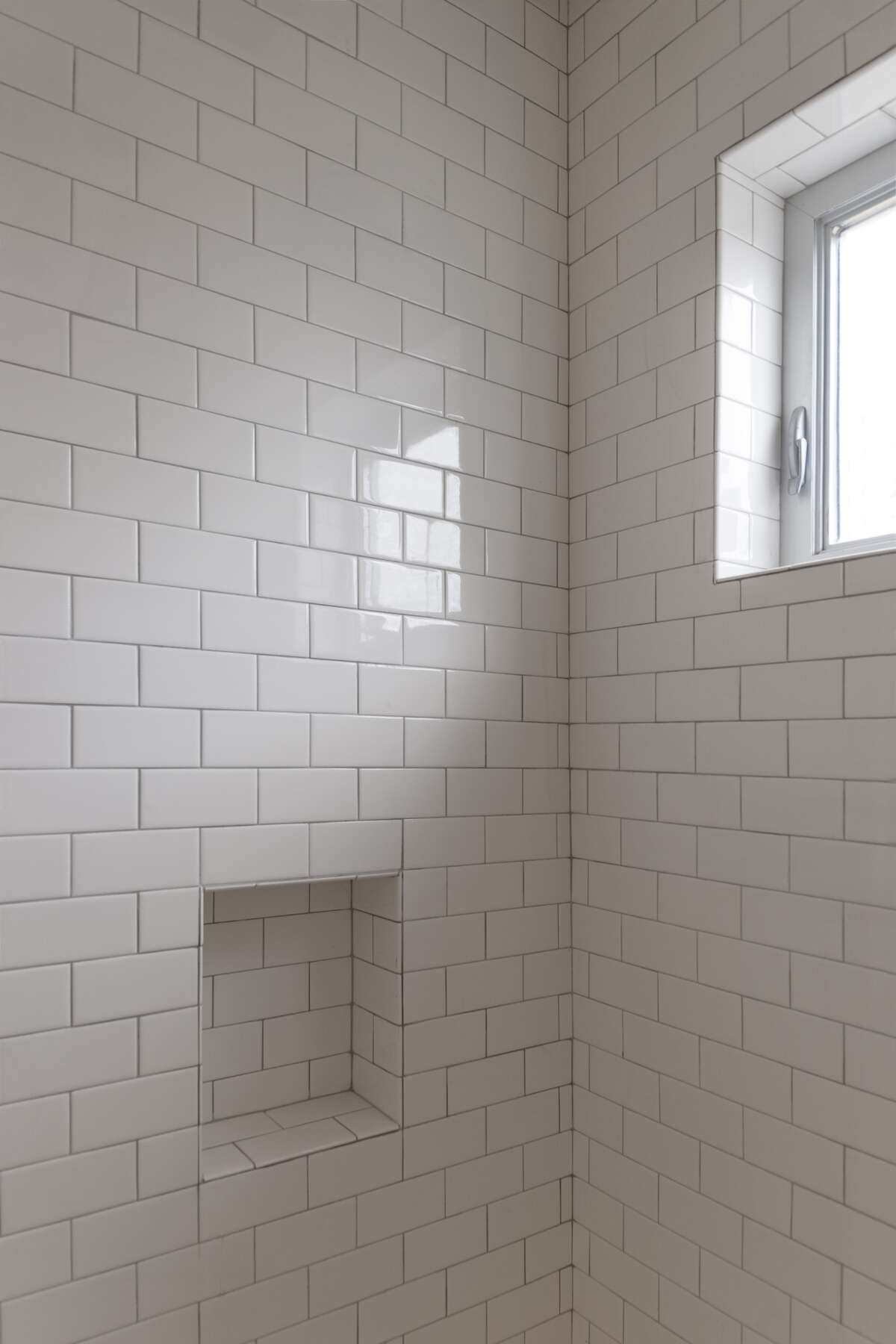 Shirkmere Lane:White subway tile covers the walls of this shower.