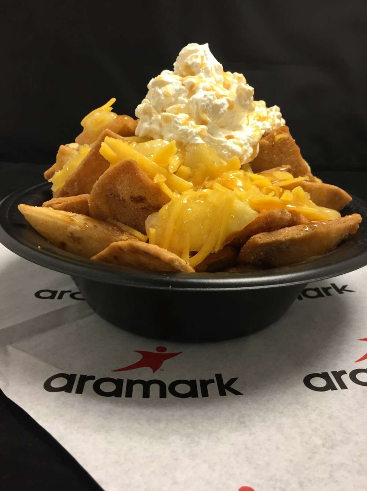 Apple Pie Nachos Coors Field (Colorado Rockies) Cinnamon sugar chips topped with apple pie filling, shredded cheddar cheese, whipped cream and caramel topping.