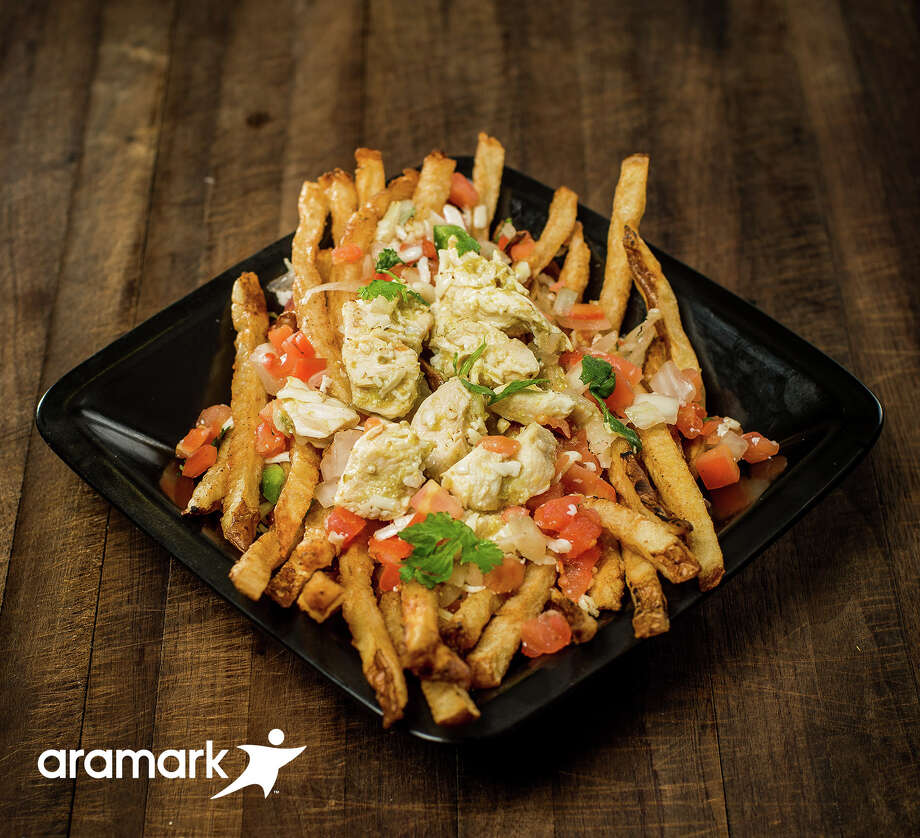 Green Chili Chicken StakMinute Maid Park (Houston Astros)Fresh cut fries topped with green chicken chili, cotija cheese and pico de gallo. Photo: Micahl Wyckoff