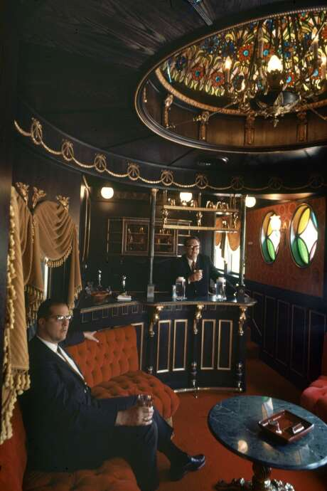 View of American politician and real estate developer, former Houston Mayor Roy Hofheinz behind the bar in his private railroad car in June 1968. Photo: Mark Kauffman/Time & Life Pictures/Getty Image