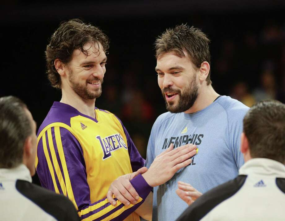 FILE - In this Nov. 15, 2013, file photo, Los Angeles Lakers' Pau Gasol, left, of Spain, and his brother, Memphis Grizzlies' Marc Gasol talk to referees before an NBA basketball game in Los Angeles. The NBA announces, Thursday, Jan. 22, 2015,  the 10 players voted by fans to start in next month's All-Star game in New York, with brothers Pau and Marc Gasol in position to face each other after the last update. (AP Photo/Jae C. Hong, File) Photo: Jae C. Hong, STF / Associated Press / AP