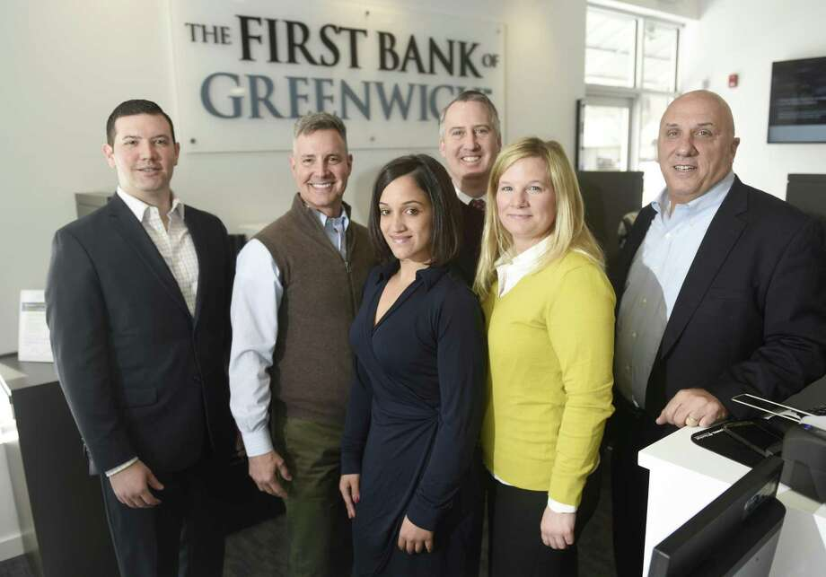 From left, Chief Lending Officer Evan Corsello, COO Mark McMillen, Universal Banker Amy Sellers, Branch Manager Stephen Tedesco, Assistant VP and Retail Bank Manager Emily Newcamp, and President and CEO Frank Gaudio pose at the First Bank of Greenwich branch in Stamford, Conn. Wednesday, March 15, 2017. The new branch is the third FBOG location, joining the exisiting headquarters in Cos Cob and lending office across the street from the new location on Summer Street. Photo: Tyler Sizemore / Hearst Connecticut Media / Greenwich Time