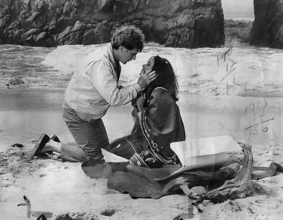 "Richard Burton and Elizabeth Taylor in 1965's ""The Sandpiper."""