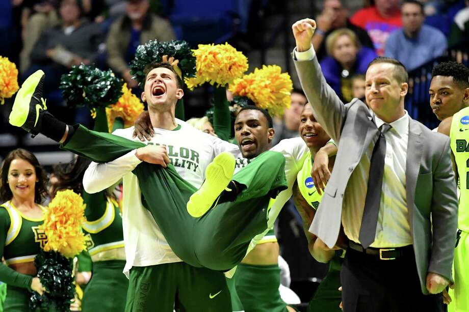 TULSA, OK - MARCH 17:  The Baylor Bears bench celebrates in the second half against the New Mexico State Aggies during the first round of the 2017 NCAA Men's Basketball Tournament at BOK Center on March 17, 2017 in Tulsa, Oklahoma. Photo: J Pat Carter, Getty Images / 2017 Getty Images