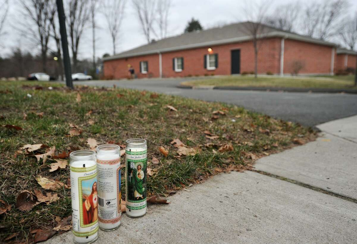 Memorial candles on the sidewalk outside the Kingdom Hall of Jehovah's Witnesses in Bridgeport in 2014 where Jacob Lopez was shot and killed. Griselle Pizarro has been found not guilty of murder and lesser manslaughter charges in the fatal shooting of Lopez.