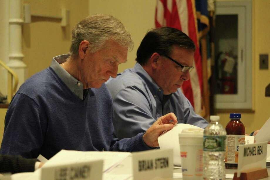 Finance board members John Hartwell and James Westphal look over the school budget at their March 16, 2017 meeting. Photo: Chris Marquette / Hearst Connecticut Media / Westport News