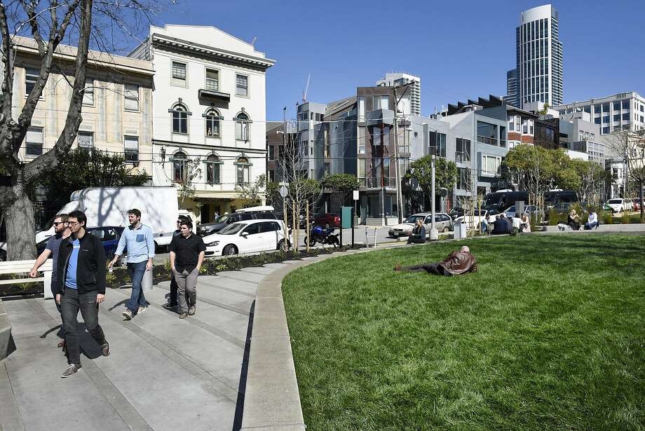 People walk through the newly designed and renovated South Park in San Francisco, CA, on Friday March 17, 2017. Photo: Michael Short, Special To The Chronicle