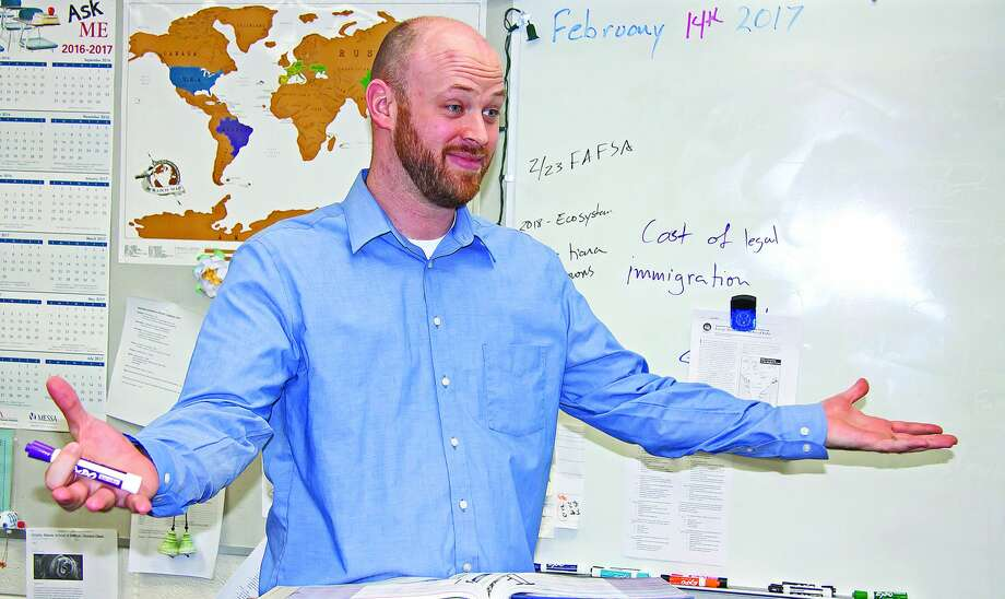 Teacher Kevin Parker makes a point to students. Photo: Bill Diller/For The Tribune