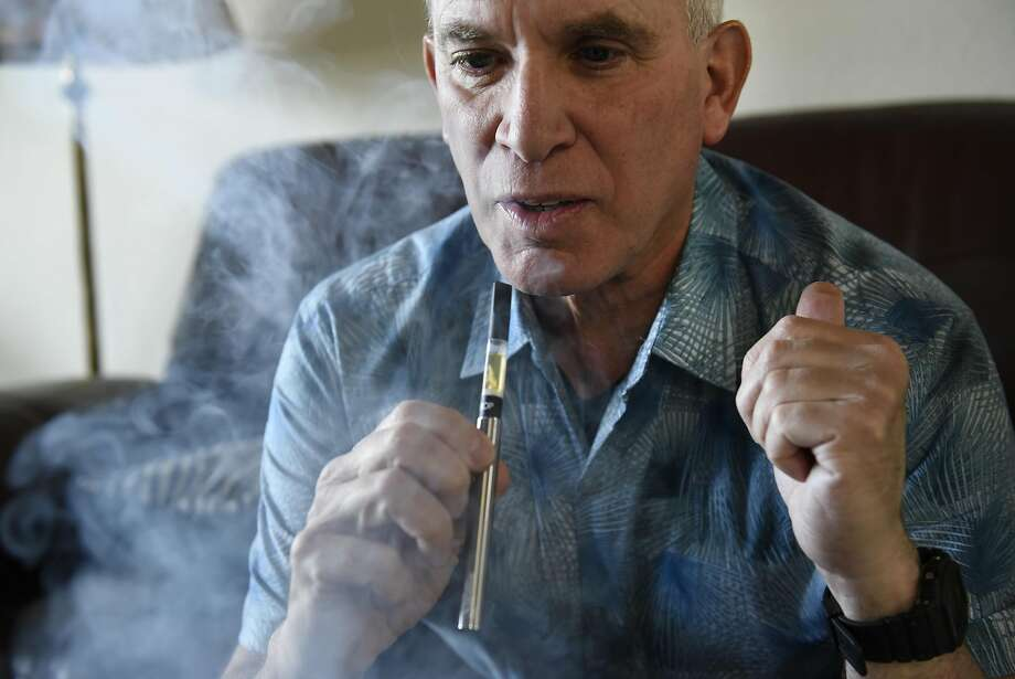 David Goldman takes a puff from a vape pen at his home in San Francisco. Photo: Michael Short, Special To The Chronicle
