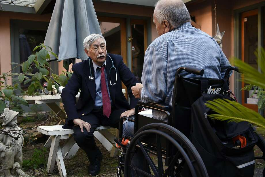 Dr. Floyd Huen meets with Apothecarium patient Dieter Schien at his home in San Anselmo. Photo: Michael Short, Special To The Chronicle