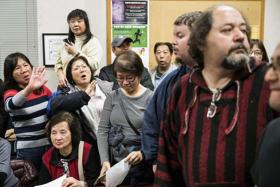 People react as the police temporarily suspend a community meeting regarding the proposed medical cannabis dispensary after a largely angry crowd exceeded the room's capacity at the Taraval Police Station's community room March 2. Photo: Stephen Lam, Special To The Chronicle