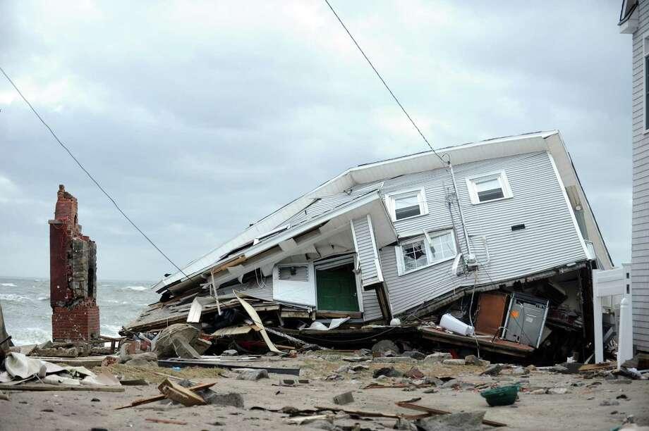 A house destroyed during Hurricane Sandy Tuesday, Oct. 30, 2012 on Fairfield Beach Road in Fairfield, Conn. Photo: Autumn Driscoll / Hearst Connecticut Media File Photo / Connecticut Post