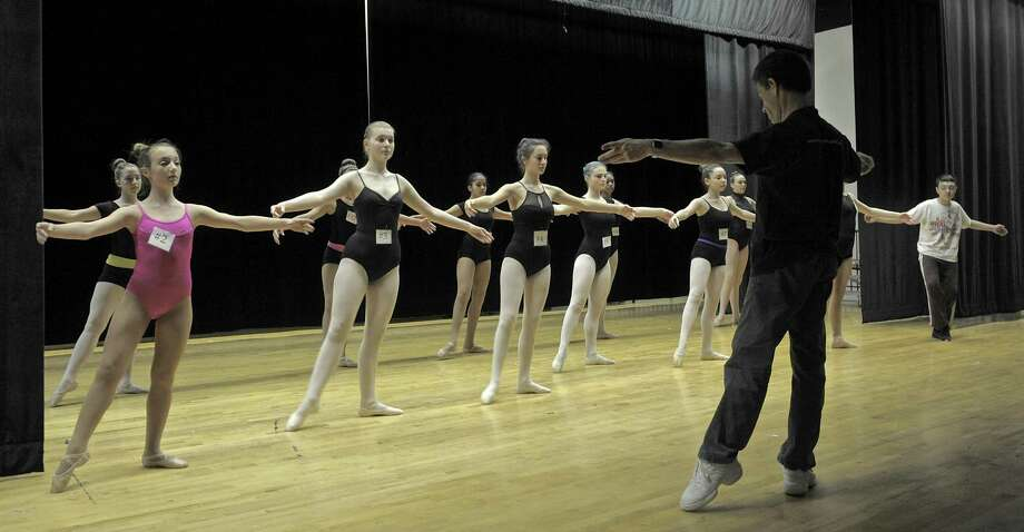 Artistic Director Brett Raphael leads dance students in a warm up before Connecticut Ballet's open auditions for dance scholarships, for middle and high school students from Danbury, on Wednesday, May 13, 2015, at Broadview Middle School, in Danbury, Conn. The Khalda Logan Dance Scholarships are named in memory of Khalda Logan, an original member of the Ballet's Danbury Dance Initiative Task Force and a Western Connecticut State University faculty member who died of cancer seven years ago. Photo: H John Voorhees III / H John Voorhees III / The News-Times