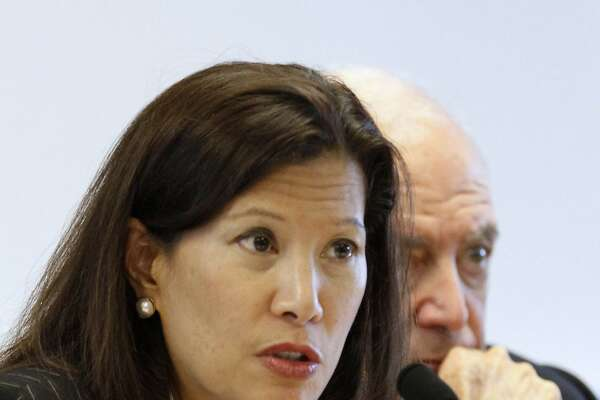 California Supreme Court Chief Justice Tani Cantil-Sakauye discusses Gov. Jerry Browns revised state budget plan and it's effects on the state's courts during a meeting of the Judicial Council of California in Sacramento, Calif., Thursday,  May 17, 2012.   At right is state Supreme Court Justice Marvin Baxter. (AP Photo/Rich Pedroncelli)