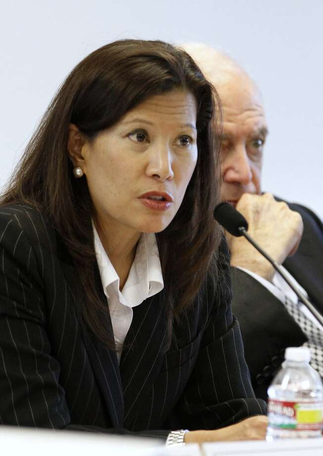 California Supreme Court Chief Justice Tani Cantil-Sakauye discusses Gov. Jerry Browns revised state budget plan and it's effects on the state's courts during a meeting of the Judicial Council of California in Sacramento, Calif., Thursday,  May 17, 2012.   At right is state Supreme Court Justice Marvin Baxter. (AP Photo/Rich Pedroncelli) Photo: Rich Pedroncelli, Associated Press