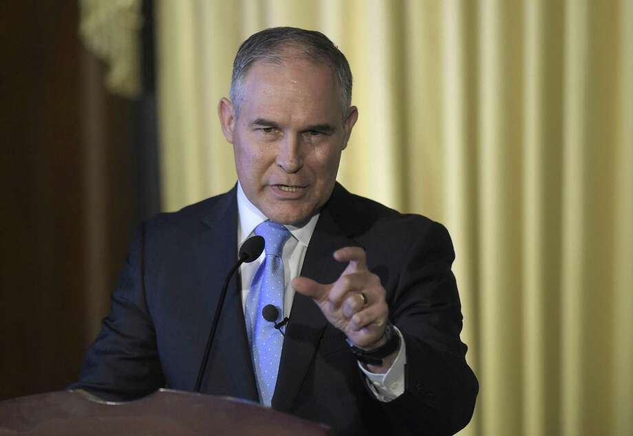 A reader criticizes Scott Pruitt, the new head of the Environmental Protection Agency, for saying he does not believe carbon dioxide contributes to climate change. Photo: Susan Walsh /Associated Press / Copyright 2017 The Associated Press. All rights reserved.
