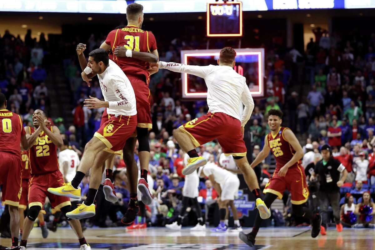 TULSA, OK - MARCH 17: The USC Trojans celebrate defeating the Southern Methodist Mustangs during the first round of the 2017 NCAA Men's Basketball Tournament at BOK Center on March 17, 2017 in Tulsa, Oklahoma.