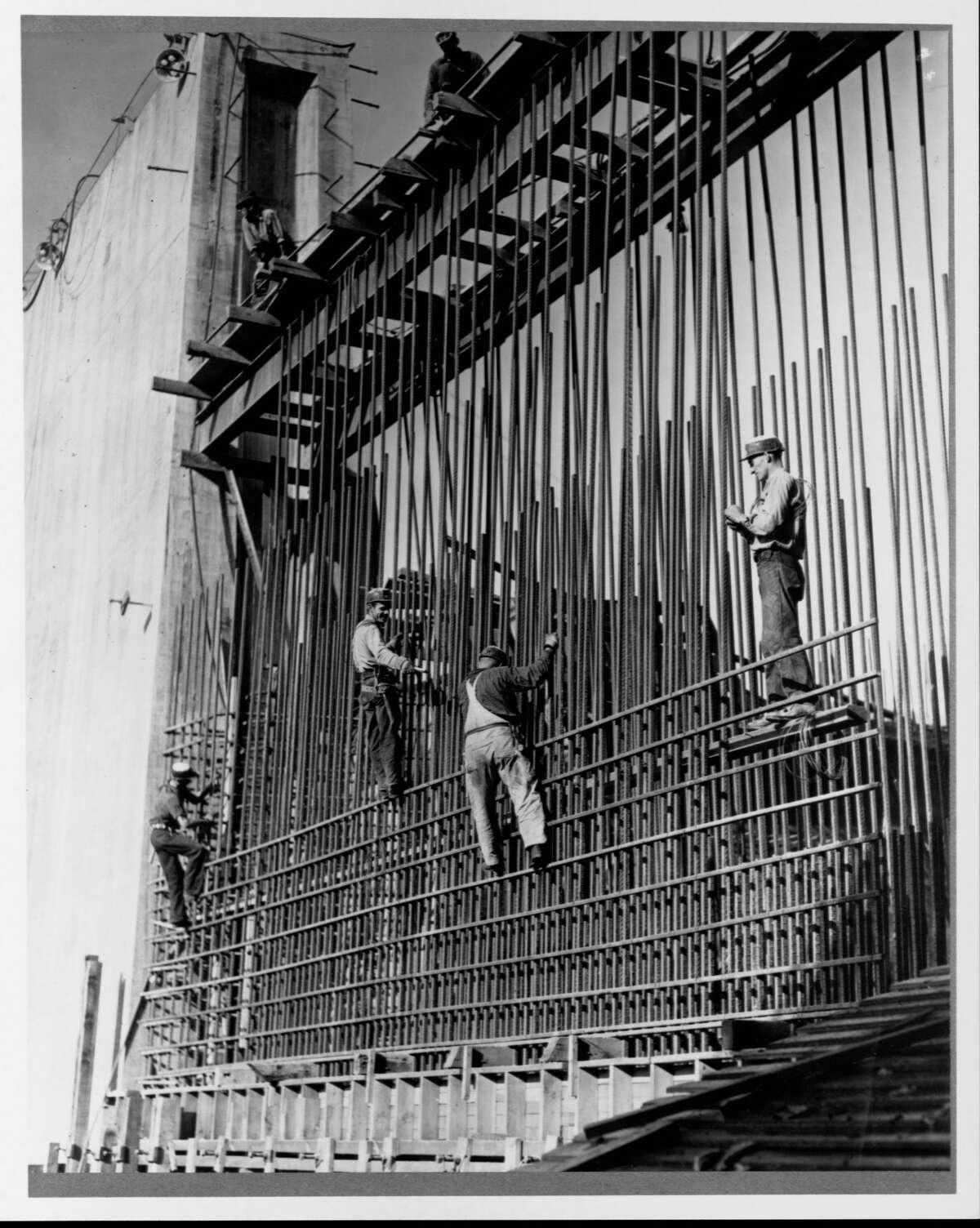 Construction workers build the steel rod frame of a wall in Grand Coulee Dam. November, 1937. (Photo by Library of Congress/Corbis/VCG via Getty Images)