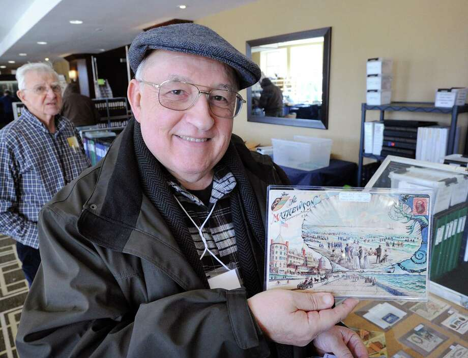 "Postcard vendor Jose Rodriquez holds up a mailed 1901 postcard sent July 3rd from Narragansett, Rhode Island, that he will be selling for $200 at the Ephemera Society of America's Ephemera/37 Fair at the Hyatt Regency Greenwich, Conn., Friday afternoon, March 17, 2017. The hours for the fair are, Saturday 10 a.m. - 5 p.m. and Sunday 11 a.m. - 4 p.m. Marvin Getman who is organizing the event that features antiquarian & collectible paper, said ""I like to say we are like a museum except that you can actually buy something here and walk out the door with it. You can't do that at a museum."" Photo: Bob Luckey Jr. / Hearst Connecticut Media / Greenwich Time"
