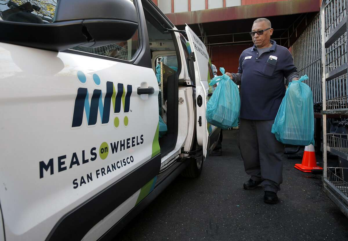Driver Felipe Mejia loads up his van for distribution from the Meals on Wheels kitchen, in San Francisco. on Fri. March 17, 2017.