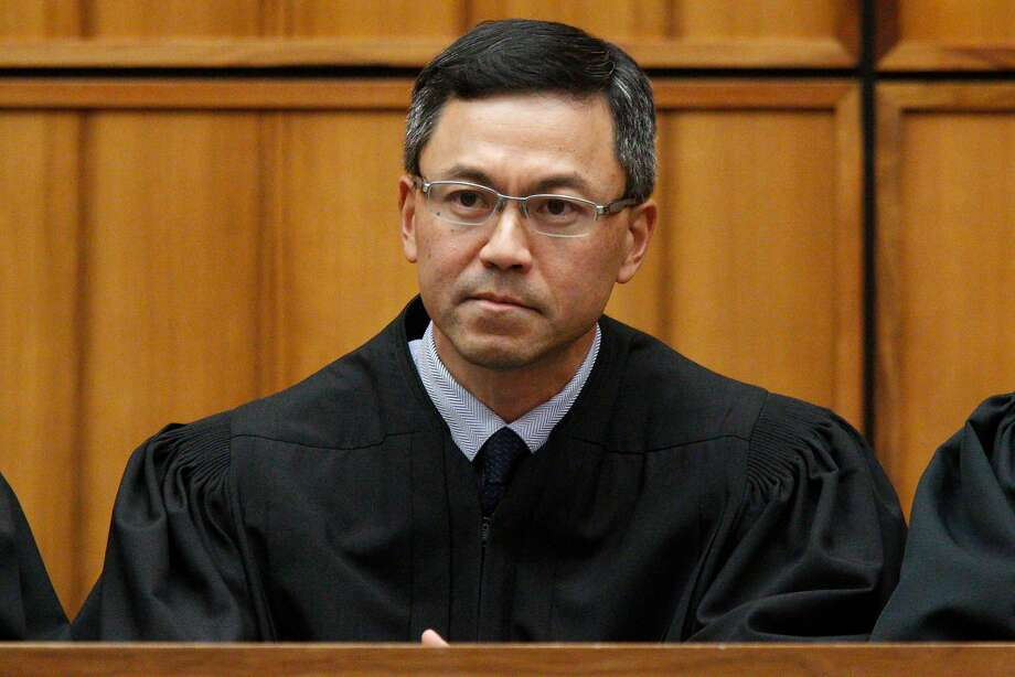 This December 2015 photo shows U.S. District Judge Derrick Watson in Honolulu. Hours before it was to take effect, President Donald Trump's revised travel ban was put on hold Wednesday, March 15, 2017, by Watson, a federal judge in Hawaii who questioned whether the administration was motivated by national security concerns. (George Lee/The Star-Advertiser via AP) Photo: George F. Lee, Associated Press