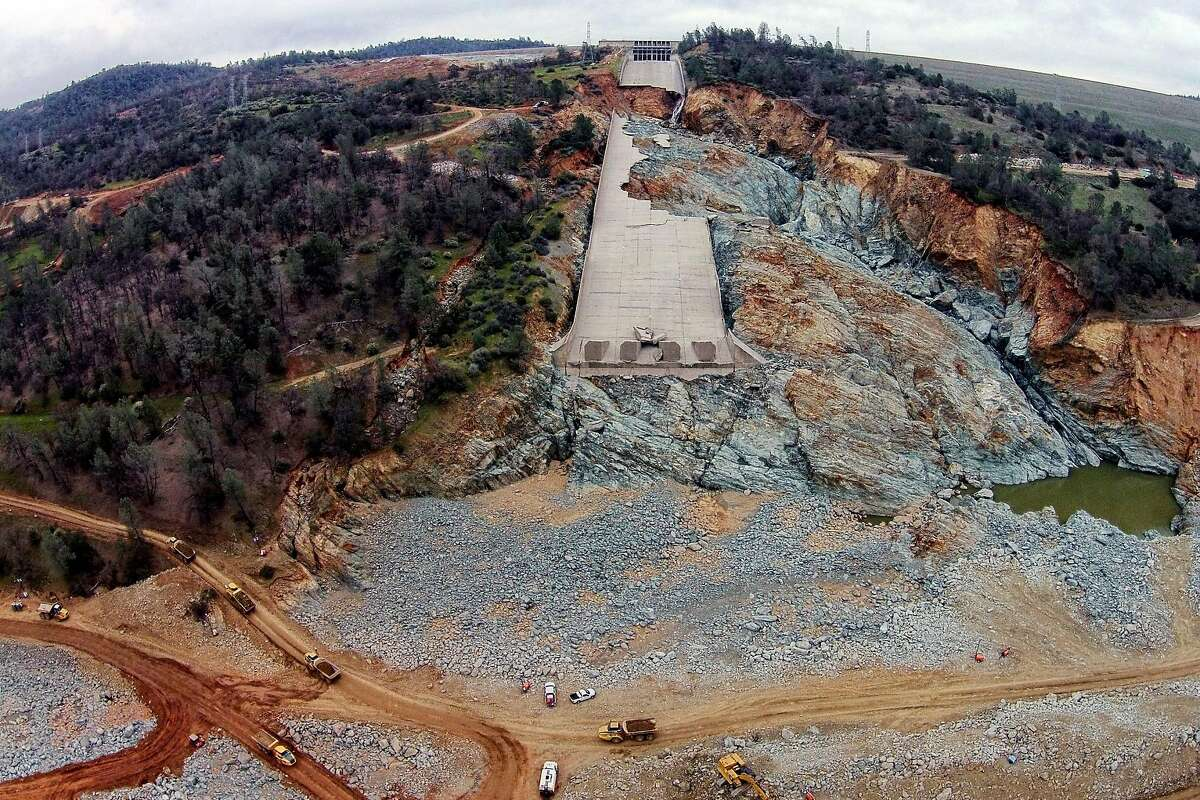 The damaged main spillway of the Oroville Dam is seen as officials continue to work on clearing debris from the bottom on Friday, March 3, 2017, in Oroville, Calif.