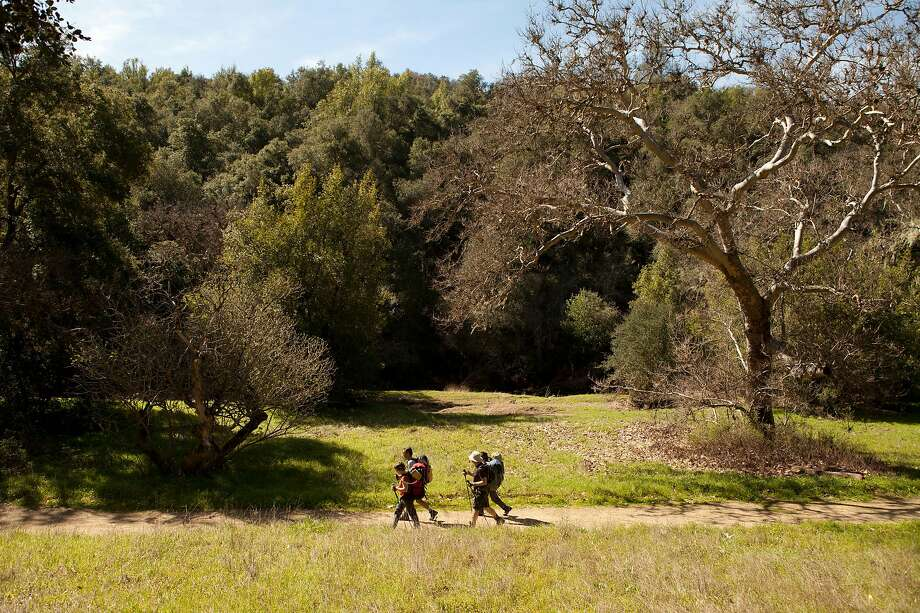 A group of backpackers walk along a path near the Hunting Hollow Entrance of Henry W. Coe State Park in Morgan Hill Calif. on Saturday March 11, 2017. The park is well known for its rugged terrain and plentiful hiking trails. Photo: Alex Washburn / The Chronicle