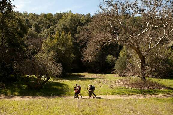 A group of backpackers walk along a path near the Hunting Hollow Entrance of Henry W. Coe State Park in Morgan Hill Calif. on Saturday March 11, 2017. The park is well known for its rugged terrain and plentiful hiking trails.