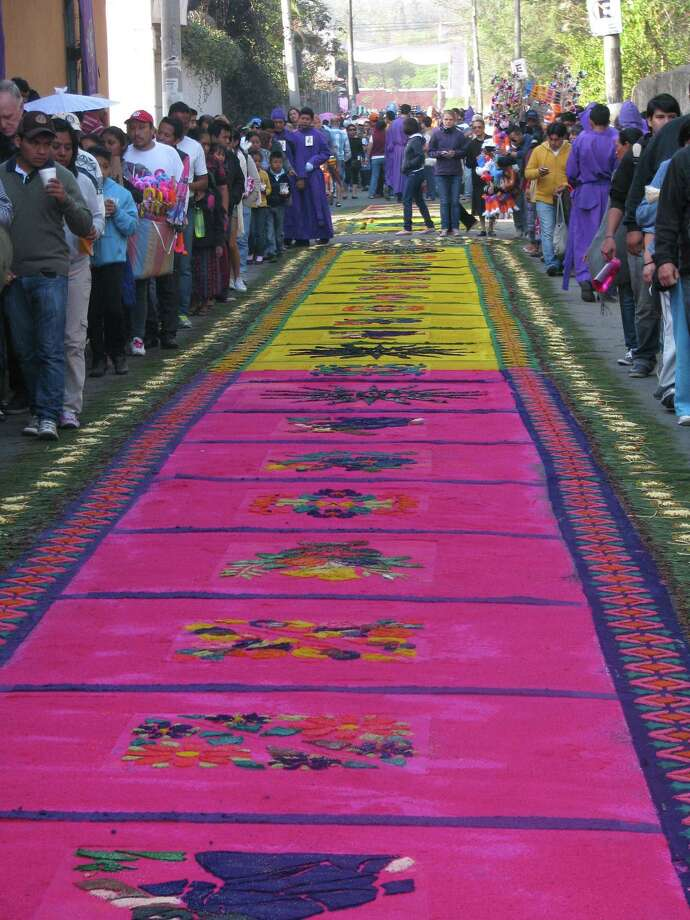 A block-long, intricately designed carpet made of colored sawdust covers the route where religious processions pass during the Easter season. Photo: Giovanna Dell'Orto, HONS / Giovanna Dell'Orto