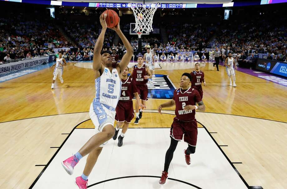GREENVILLE, SC - MARCH 17:   Tony Bradley #5 of the North Carolina Tar Heels shoots against Zach Lofton #2 of the Texas Southern Tigers in the first half during the first round of the 2017 NCAA Men's Basketball Tournament at Bon Secours Wellness Arena on March 17, 2017 in Greenville, South Carolina.  (Photo by Kevin C. Cox/Getty Images) Photo: Kevin C. Cox/Getty Images