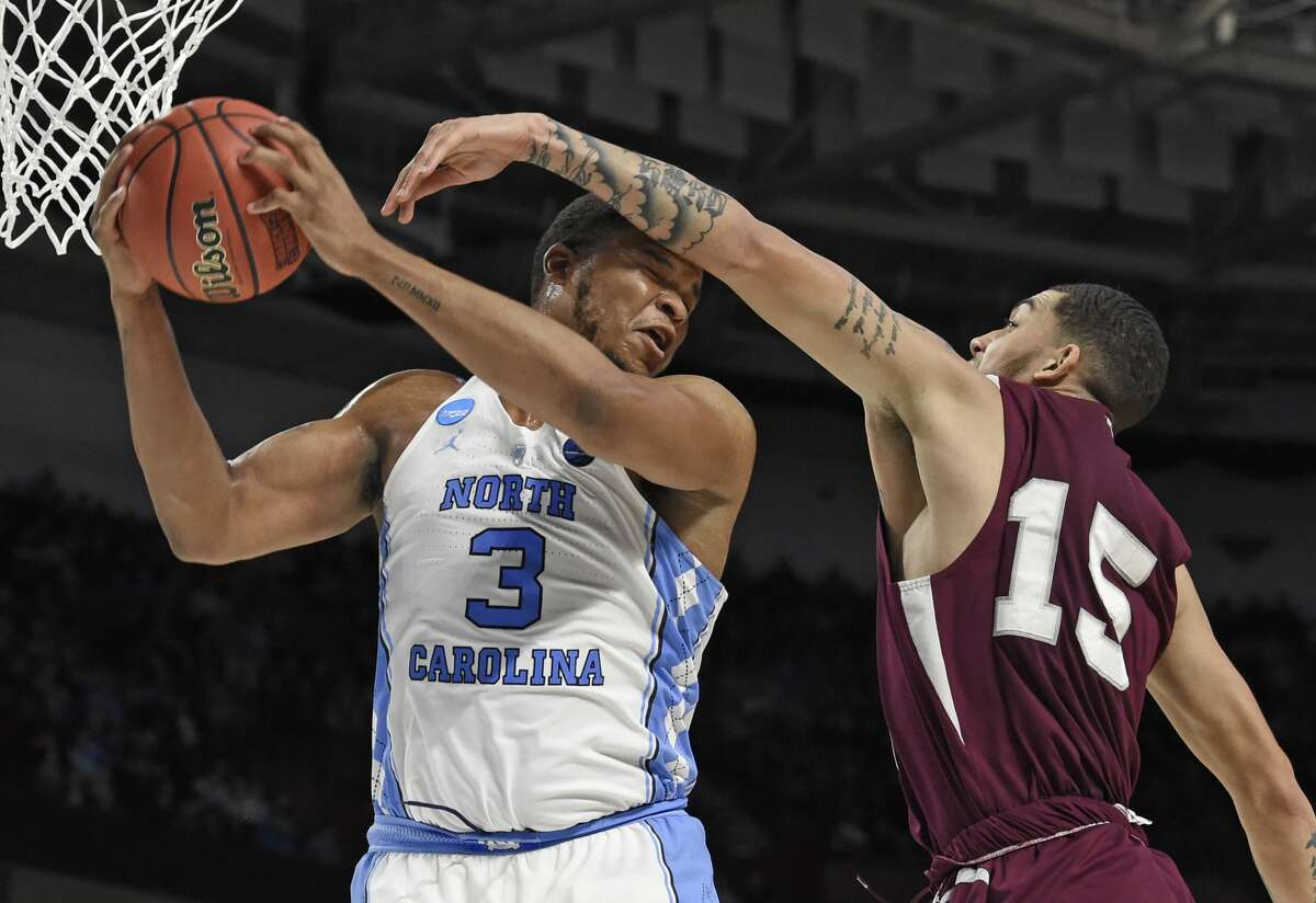 North Carolina's Kennedy Meeks (3) grabs a rebound against Texas Southern's Stephan Bennett (15) during the second half in a first-round game of the NCAA men's college basketball tournament in Greenville, S.C., Friday, March 17, 2017. (AP Photo/Rainier Ehrhardt)